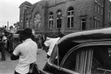 Firetruck and hearse parked outside of 16th Street Baptist Church in Birmingham, Alabama, after the building was bombed.