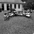 Nun teaching children on the lawn of Nazareth Catholic Mission in Montgomery, Alabama.