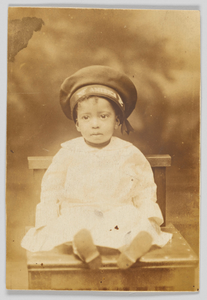 Photographic postcard with image of a small child